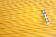 Made in Italy label over uncooked Italian spaghetti Stock Photo