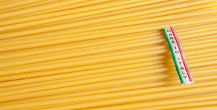 Made in Italy label over uncooked Italian spaghetti Royalty Free Stock Images