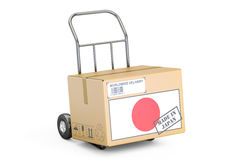 Made in Japan concept. Cardboard Box on Hand Truck, 3D rendering Stock Photography