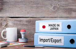 Made In Japan. Two binders on desk in the office. Business backg Stock Image