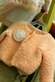 Made Just For You. Macro of hand knit child's sweater royalty free stock photography