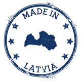 Made in Latvia stamp. Grunge rubber stamp with Made in Latvia text and country map. Lively vector illustration royalty free illustration