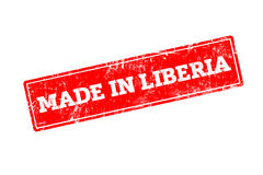 MADE IN LIBERIA word written on red rubber stamp. With grunge edges Stock Images