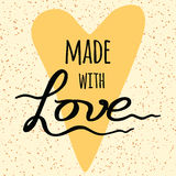 Made with love. Lettering design element into yellow heart shape. Royalty Free Stock Images