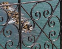 Looking at the sea through a railing royalty free stock images