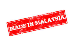 MADE IN MALAYSIA. Word written on red rubber stamp with grunge edges Royalty Free Stock Photo