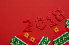 2018 made from mini bead ornament isolated on red background with space for text. Royalty Free Stock Photography