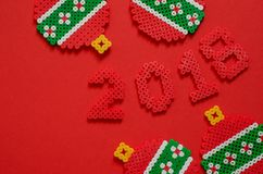 2018 made from mini bead ornament isolated on red background with space for text. Stock Image