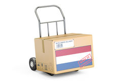Made in Netherlands concept. Cardboard Box on Hand Truck, 3D ren Royalty Free Stock Photography