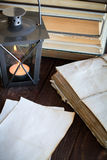 Made old sheets of paper, books and candle. On a wooden table Stock Image