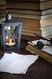 Made old sheets of paper on a wooden table. Made old sheets of paper, books and candle on a wooden table Stock Photos