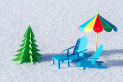 Made from paper chairs and a Christmas tree stand in the snow. Winter background. Stock Image