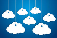 Made of paper clouds are hanging on the ropes Stock Image