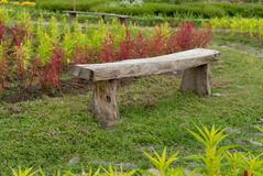 Simple seating design in a flower garden stock images