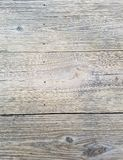 Wood background texture, knots, nail marks, closeup of table outdoors. Planks in horizontal alignment on surface. royalty free stock photos