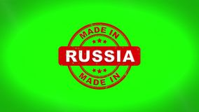 Made In Russia signed stamping text wooden stamp animation. Red ink on clean white paper surface background with green matte background included royalty free illustration