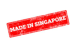 MADE IN SINGAPORE. Word written on red rubber stamp with grunge edges Royalty Free Stock Image