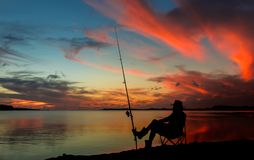 Sunset Fishing. Made sitting by his fishing rod at sunset Stock Photos