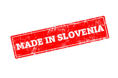MADE IN SLOVENIA. Word written on red rubber stamp with grunge edges Royalty Free Stock Images