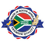Made in South Africa. Trusted brand, Premium quality. Grunge printable stamp, label and sign with national flag colors and thumbs up. Print colors used Royalty Free Stock Photography