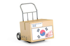 Made in South Korea concept. Cardboard Box on Hand Truck, 3D ren Royalty Free Stock Images