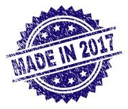 Grunge Textured MADE IN 2017 Stamp Seal. MADE IN 2017 stamp seal watermark with distress style. Blue  rubber print of MADE IN 2017 label with corroded texture Stock Photo