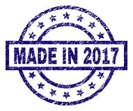 Scratched Textured MADE IN 2017 Stamp Seal. MADE IN 2017 stamp seal watermark with grunge texture. Designed with rectangle, circles and stars. Blue  rubber print Royalty Free Stock Photography