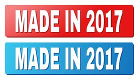 MADE IN 2017 Text on Blue and Red Rectangle Buttons. MADE IN 2017 text on rounded rectangle buttons. Designed with white title with shadow and blue and red Royalty Free Stock Photography