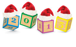 2015 made from toy blocks with christmas hats Royalty Free Stock Photos