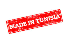 MADE IN TUNISIA. Word written on red rubber stamp with grunge edges Stock Photos