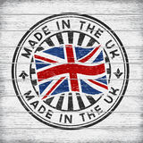 Made in the UK. Stamp on wooden background Royalty Free Stock Photo