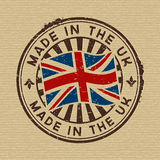 Made in the UK. Stamp on wooden background Royalty Free Stock Photography