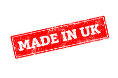 MADE IN UK. Word written on red rubber stamp with grunge edges Stock Photo