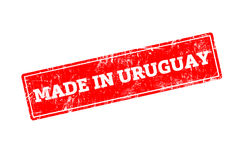 MADE IN URUGUAY. Word written on red rubber stamp with grunge edges Stock Images