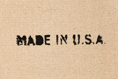 Made in USA. Black label on brown cardboard Royalty Free Stock Photography