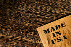 Made in USA Grunge Paper on Old Wood Background Royalty Free Stock Photo