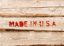 Made in USA. Red label on wooden box Stock Photography