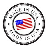 Made in USA, retro grunge stamp with USA flag. Made in USA, retro grunge stamp with USA flag inside, isolated on white. Vector stamp illustration. Trade mark Royalty Free Stock Images