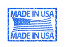 Made in USA stamp. Grunge rubber stamp with the flag of the United States of America and the text made in USA written inside the stamp Royalty Free Stock Photography