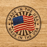 Made in the USA. Stamp on wooden background Royalty Free Stock Photography