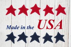 Made in the USA text with patriotic red and blue stars royalty free stock photo
