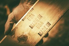 Made in the USA Theme. Piece of Lumber in Carpenters Hand stock images