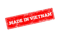 MADE IN VIETNAM. Word written on red rubber stamp with grunge edges Stock Photography