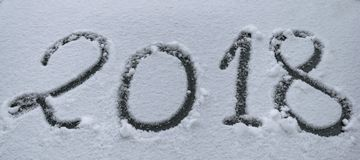 2018 made on the windshield of a car in snow stock photography