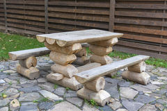 Made from wooden logs table and benches outdoor Royalty Free Stock Photos