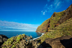 Madeira coast - cliffs on the western part of Portuguese island. Royalty Free Stock Image