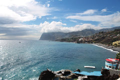 Madeira coast and lava swimming pool in Funchal Stock Photos