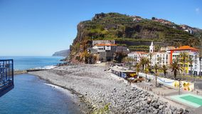 Madeira Coastline, Beach Fishing Village, Portugal. Madeira scenic coastline, beach in fishing village with church on the South coast. Madeira Island, Portugal Stock Image