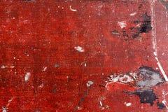 Madeira com pintura vermelha lascada Fundo do estilo de Grunge Fotografia de Stock Royalty Free