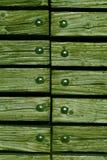 Madeira com rebites Imagens de Stock
